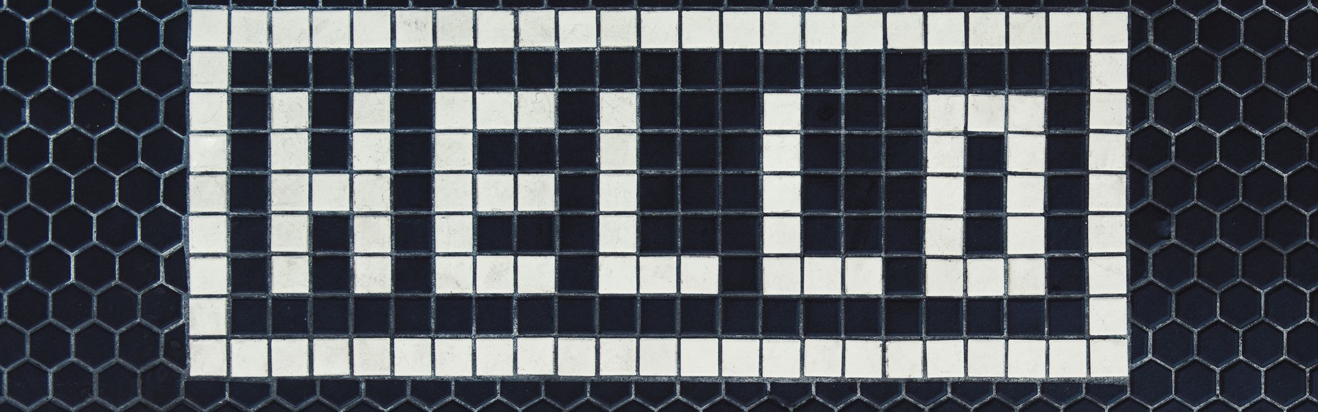 Hello spelled out in Tiles on a Hexagonal Tiled Floor